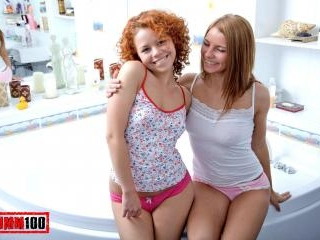 Young lesbian sluts playing anal dildo in the tub