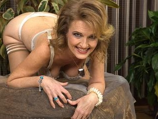 Naughty mature lady playing by herself
