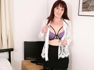 Naughty British housewife playing with her toys