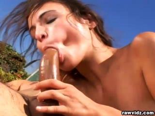 Amber Rayne blowjobs hard cock outdoors