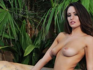 Anastasia teases down to her bikini in the pool