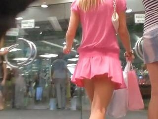 The pink outfit of this chick immediately drew my