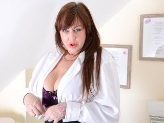 Big breasted British housewife playing with her to