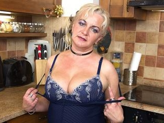 Naughty housewife playing in the kitchen