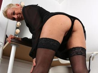 Naughty German housewife playing with her wet puss