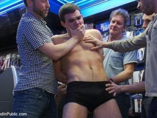 Horny men take down a cocky hustler at a busy sex