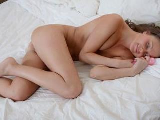 Sweet girl masturbates with toy