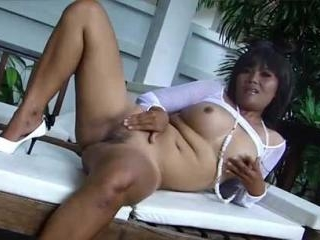 Hot Thailand chick plays with her pussy