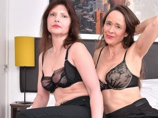 Two naughty mature lesbians getting wet and wild