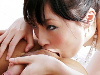 Adorable Rika plays with a cock and her tits befor