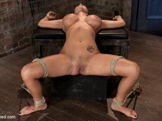 Sexy tan oiled blond, is slowly dragged into the d