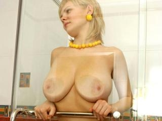 Busty blonde shows off her huge tits