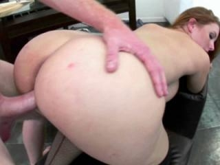 Busty redhead Rebecca Lane in fishnet stockings wh