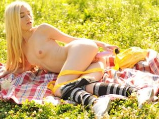 Natural beauty toys wet pussy outdoors