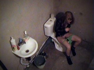 Doll examining her hairy pussy on the toilet-bowl!