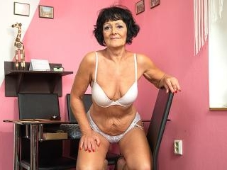 Horny older lady playing with her shaved pussy