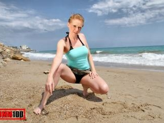 Nice blonde Angie Scorp doing a strip on the beach