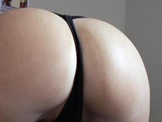 Naughty camgirl struts her thong clad ass