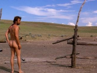 Costner parades his tan can around while enjoying