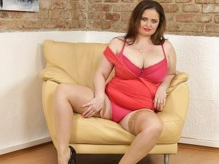 Big breasted curvy housewife playing with her puss