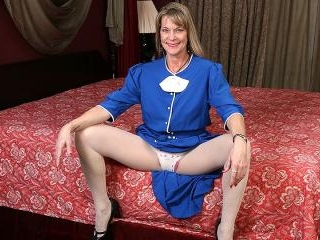 Naughty American housewife playing in bed with her